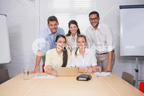 Business people working together at meeting on computer