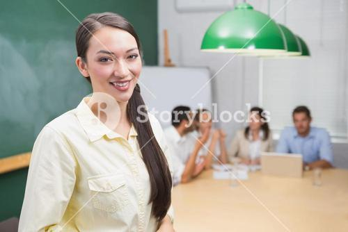 Smiling business woman leading the meeting