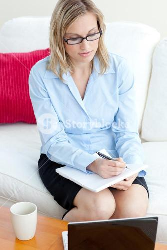 Concentrated businesswoman taking notes