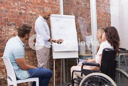 Businessman making a presentation to his fellow coworkers