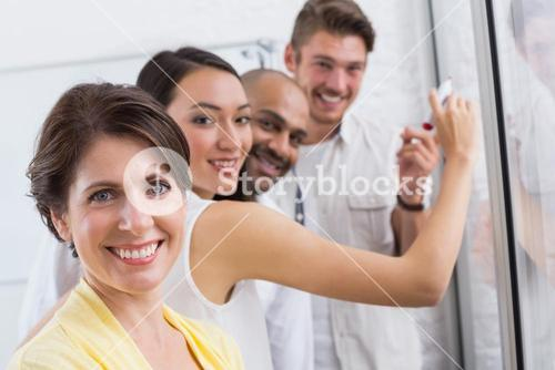 Smiling business people looking at camera during a meeting