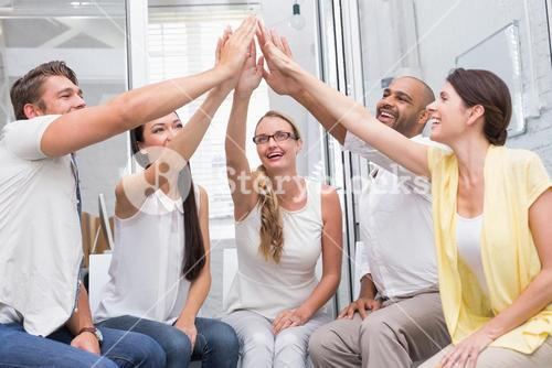 Happy business team high fiving