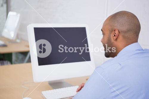 Businessman using computer at office