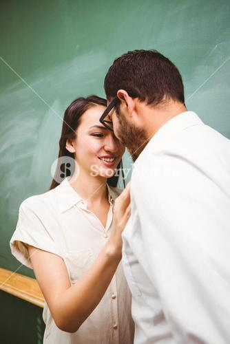 Businessman and woman looking at each other in office