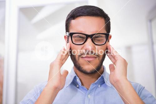 Close up of businessman with severe headache