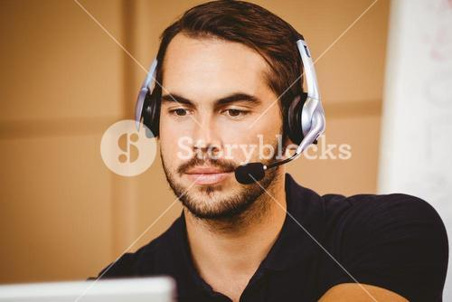 Businessman using headset in distribution warehouse