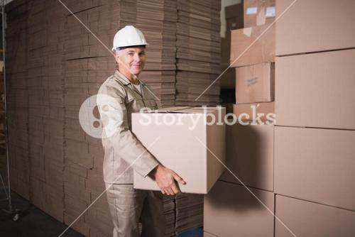 Warehouse worker loading up pallet