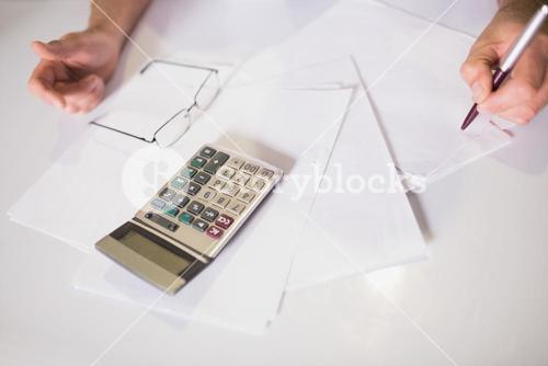 Bills and calculator on table