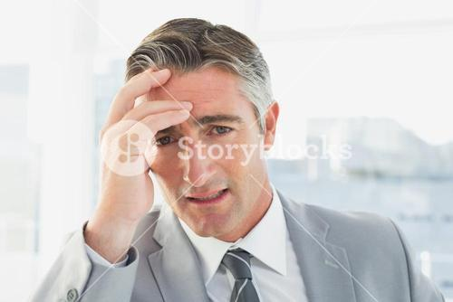 Businessman suffering from a headache