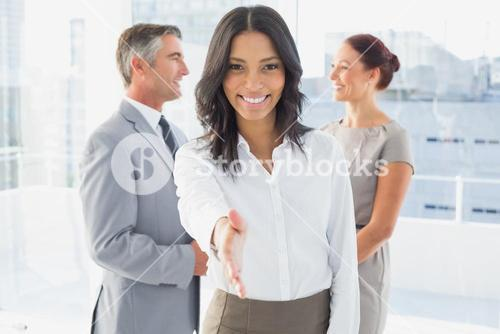 Businesswoman offering a friendly handshake