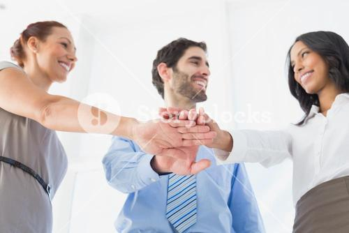 Business people with stacked hands