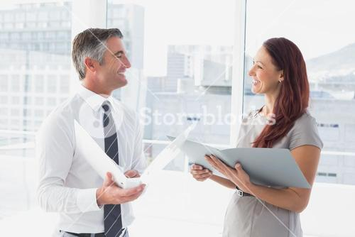 Business people smiling and talking