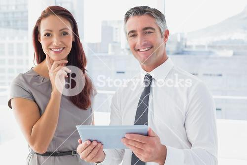 Business people smiling at camera