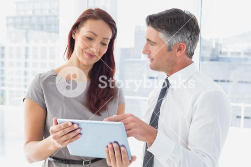Business people holding a tablet