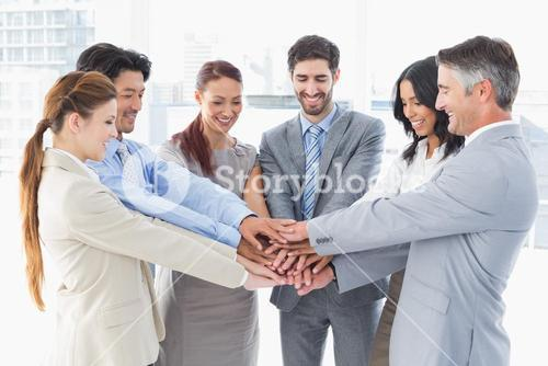 Business team stacking their hands