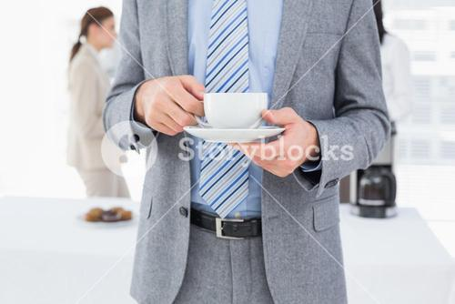 Smiling businessman with a drink