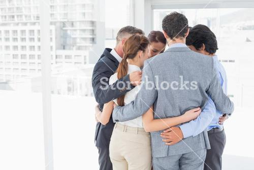 Business team all huddled together