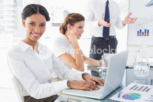 Businesswoman typing at a presentation