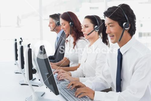 Employees typing on their computers
