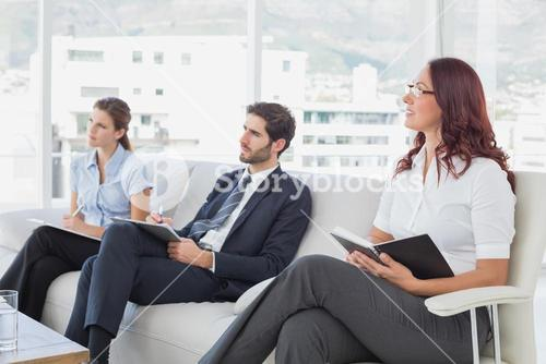 Employees listening to a presentation
