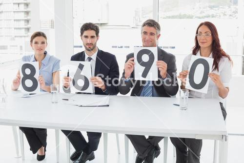 Business team giving out ratings