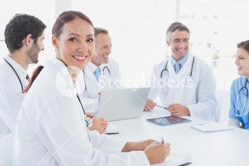 Doctors smiling and working together