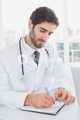 Doctor sitting and taking notes