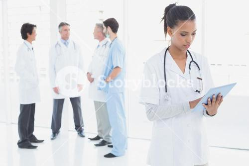Doctor looking over medical notes