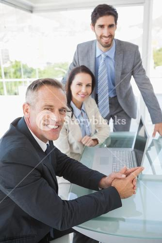 Smiling business people at work