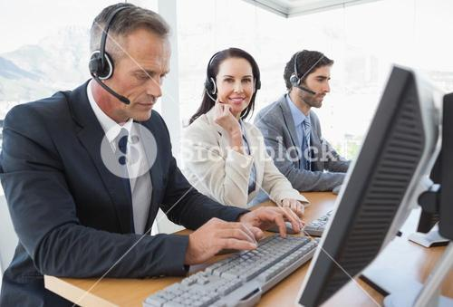 Smiling businesswoman working with teammates