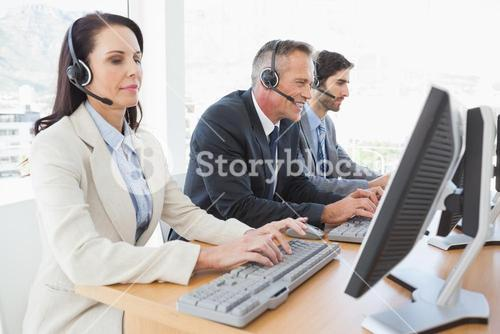 Happy businessman working with coworkers
