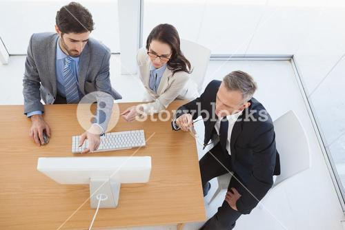 Business team watching a computer screen