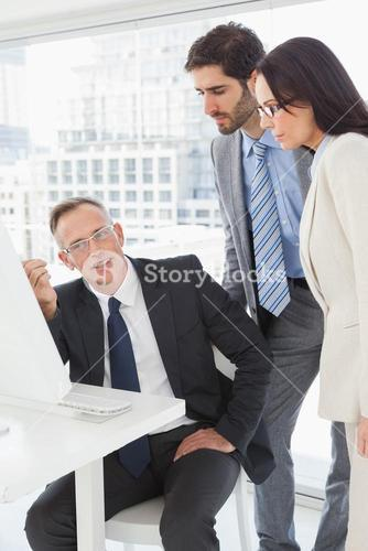 Business people looking at a computer