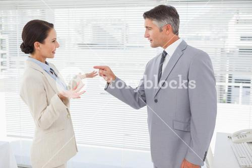 Businessman scolding his co worker