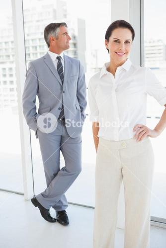 Smiling businesswoman with hand on hip