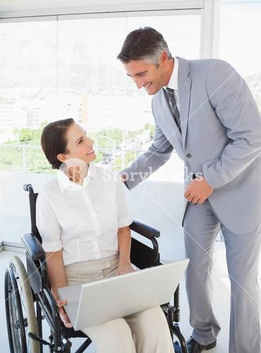 Disabled business woman working with partner