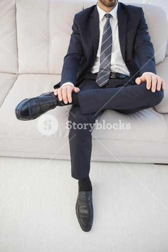 Businessman with leg on his knee