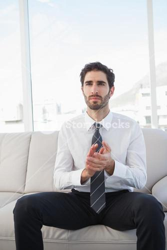 Businessman clapping while sitting down