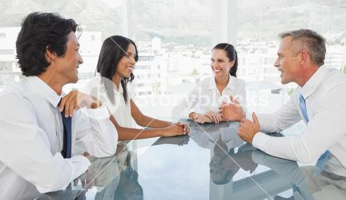 Happy business team talking together
