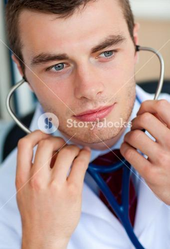 Portrait of an assertive male doctor holding a stethoscope