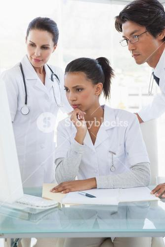 Doctors looking at a computer monitor