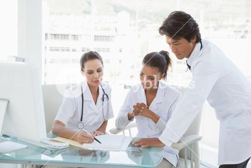 Doctors reviewing notes together