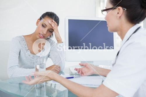 Doctor talking with upset looking patient