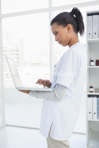 Doctor using her laptop