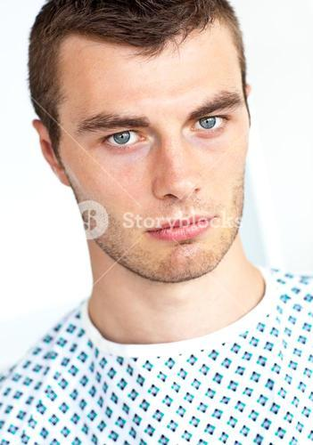 Young unhappy patient looking at camera