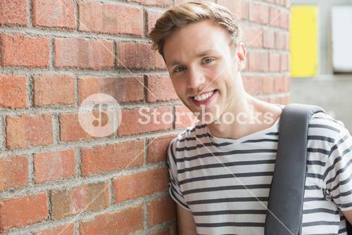 Handsome student smiling at camera