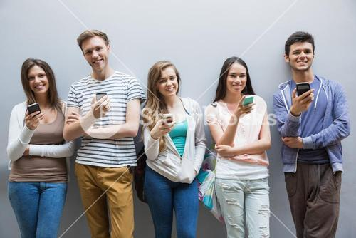 Students using their smartphones in a row
