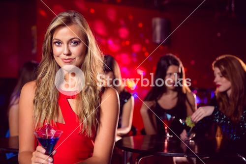 Pretty blonde drinking a cocktail
