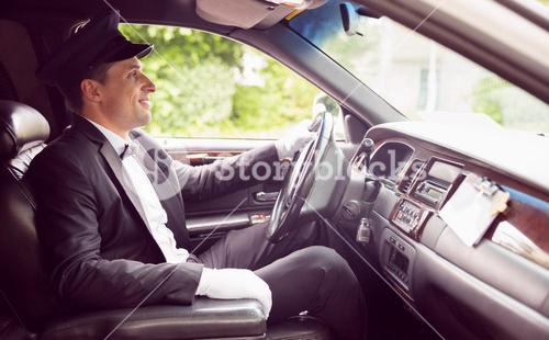 Limousine driver driving and smiling