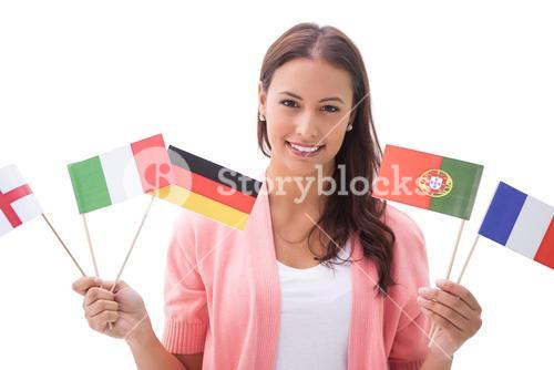 Pretty brunette smiling and holding flags